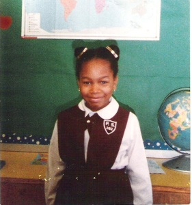 a photo of an elementary student in a classroom