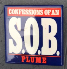 2.25 inches, square, cardboard pinback with clasp promotional button for the book Confessions of an S.O.B. Design is on navy blue background with white lettering for title, red lettering for publisher's name and white lettering on red box.