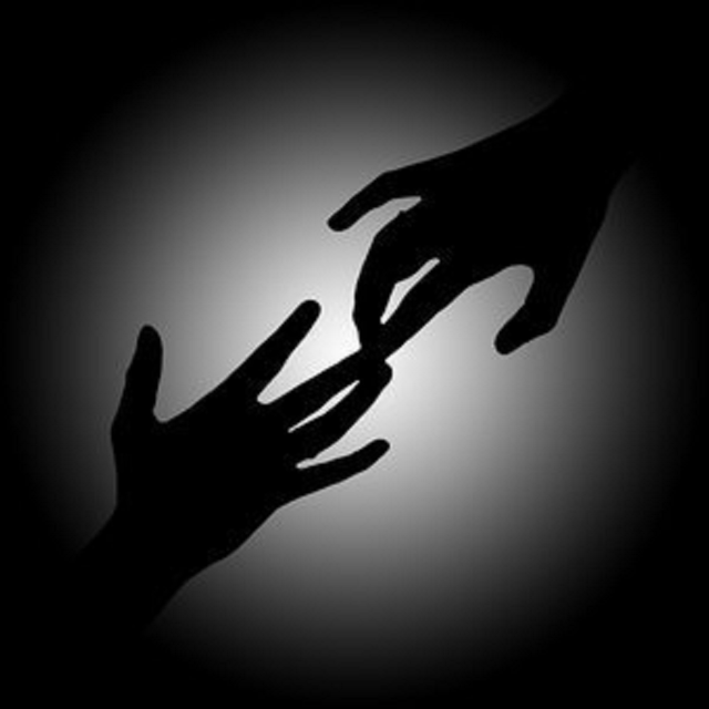 Silhouette hands with fingertips touching
