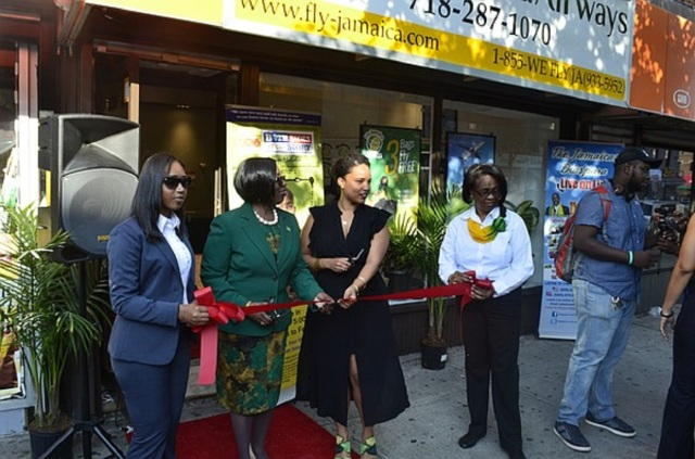 ribbon cutting ceremony outside of a store-front Fly Jamaica Airwaysoffice