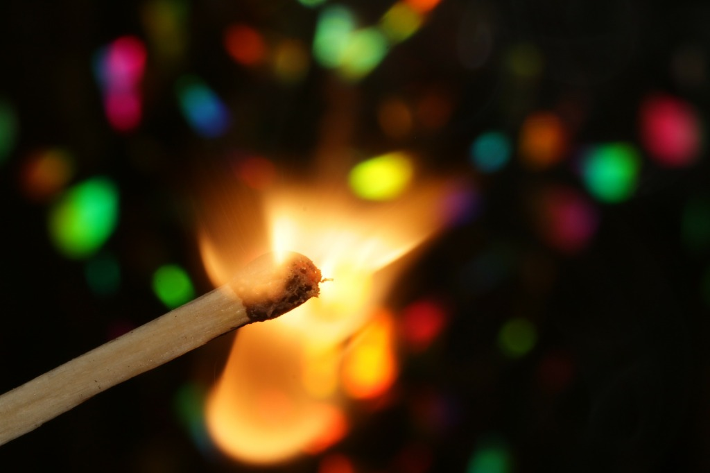 image of a flame lit match stick