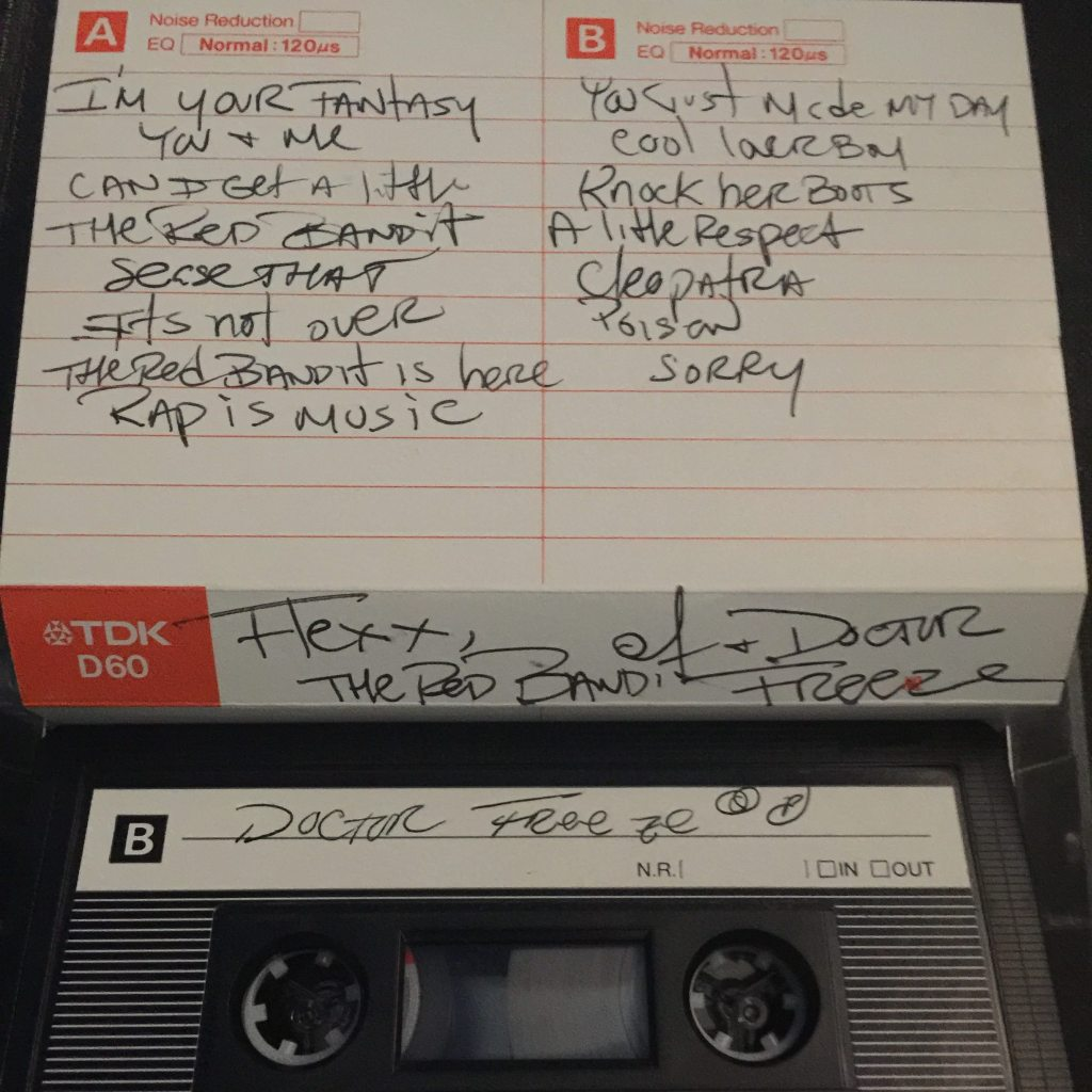 Audio cassette tape and white lined paper jacket with orange accent