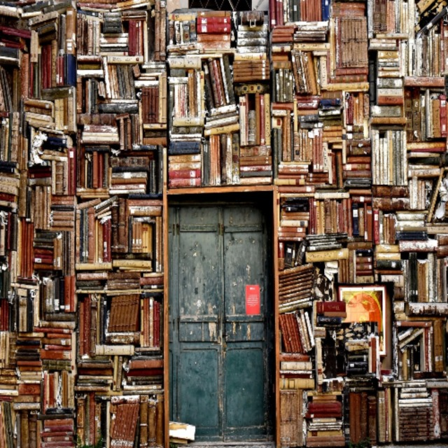 Photo of books surrounding a door entrance Italy