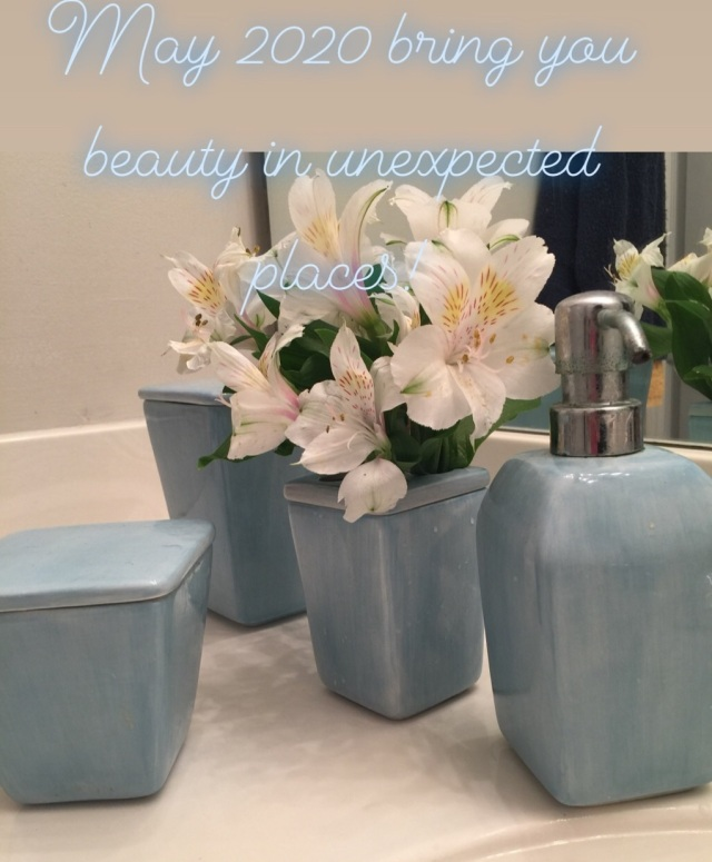 image of flowers in toothbrush holder